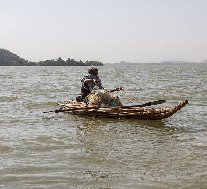 Ethiopia, Fisher Man on Papyrus Boat (Lake Tana), EastAfricaTourOperator.net