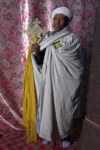 Ethiopia Priest holding a processional cross, EastAfricaTourOperator.net