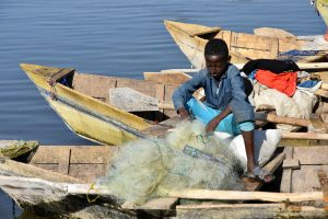 Ethiopia, A fisher boy, traditional boats in lake Hawassa, EastAfricaTourOperator.net