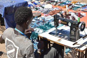 Ethiopia, Man sewing a garment using an industrial sewing machine, EastAfricaTourOperator.net