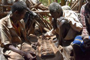 Ethiopia, Elders playing Chess Konso Village, EastAfricaTourOperator.net