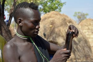 Ethiopia, A man from Mursi tribe Omo Velley, EastAfricaTourOperator.net