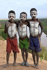 Ethiopia, Body painted boys in Karo tribe, EastAfricaTourOperator.net