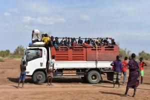 Ethiopia, Mursi tribe taking ride in Omo valley, EastAfricaTourOperator.net