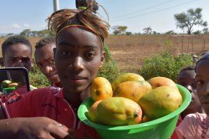 Ethiopia, Wolayita girl selling Mango, EastAfricaTourOperator.net